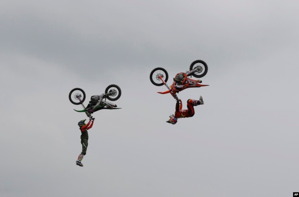 Riders perform during a freestyle motocross show at the EICMA exhibition motorcycle fair in Milan, Italy.