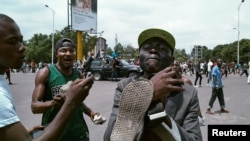 En images : violences à Kinshasa lors de la manifestation anti-Kabila