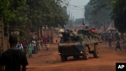 French soldiers drive through the Miskine neighborhood of Bangui, Central African Republic, Dec. 26, 2013.