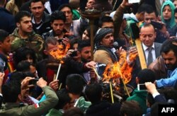Syrian Kurds light torches as they celebrate the Nowruz spring festival in the capital Damascus, March 21, 2015.