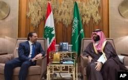 FILE - In this Oct. 30, 2017 photo, Saudi Crown Prince Mohammed bin Salman, right, meets with Lebanese Prime Minister Saad Hariri in Riyadh, Saudi Arabia.