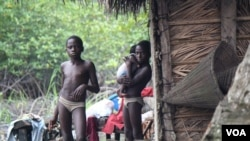In fishing villages along the creeks in the Niger Delta, locals say children are constantly sick from drinking water polluted by oil. (Heather Murdock for VOA)