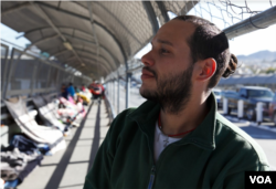 "Eddy Gonzalez is a Cuban migrant who has been on the journey to the U.S. for the past three years. ""If I have been almost three years away from my country, six days sleeping here on the floor, what's three months detained in a prison?"" Gonzalez said when talking about the possibility of ending up in immigration detention. (R. Taylor/VOA)"
