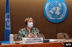 FILE - United Nations High Commissioner for Human Rights Michelle Bachelet looks on after delivering a speech on global human rights developments during a session of the Human Rights Council, in Geneva, June 21, 2021.