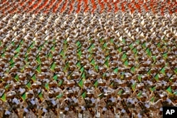 Members of the Iran's Revolutionary Guard march during an annual military parade marking the 34th anniversary of outset of the 1980-88 Iran-Iraq war, Tehran, Iran.
