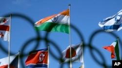 北韓國旗在南韓平昌奧運村飄揚(美聯社)