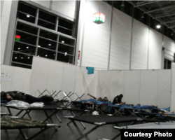 The German government has provided cots and space for refugees as thousands pour in. Refugees now in Germany say they fear the crowds coming in will make it impossible to sustain livable conditions. Courtesy photo from refugee in Germany, Sept. 19, 2015.
