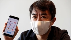 Japanese startup Donut Robotics' CEO Taisuke Ono shows the c-mask and its mobile phone application during a demonstration in Tokyo, Japan June 23, 2020. (REUTERS/Kim Kyung-Hoon)
