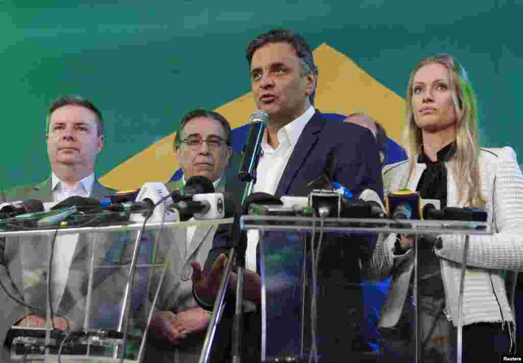 Presidential candidate Aecio Neves of the Brazilian Social Democracy Party (PSDB) gives a news conference after the official vote tally placed him second in the first round election, in Belo Horizonte, Oct. 5, 2014.