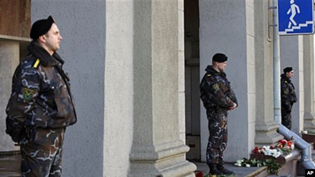 Special force officers guard an entrance to Minsk subway, after identifing suspects in Monday's bombing as the death toll rose to 12, with more than 200 wounded, April 12, 2011.