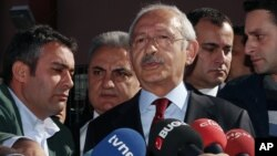 """FILE - Turkey's main opposition Republican People's Party leader Kemal Kilicdaroglu is seen speaking to the media in Ankara, Turkey, Nov. 1, 2015. Of Thursday's court decision he said it """"revealed how right in our criticisms we were in the past."""""""