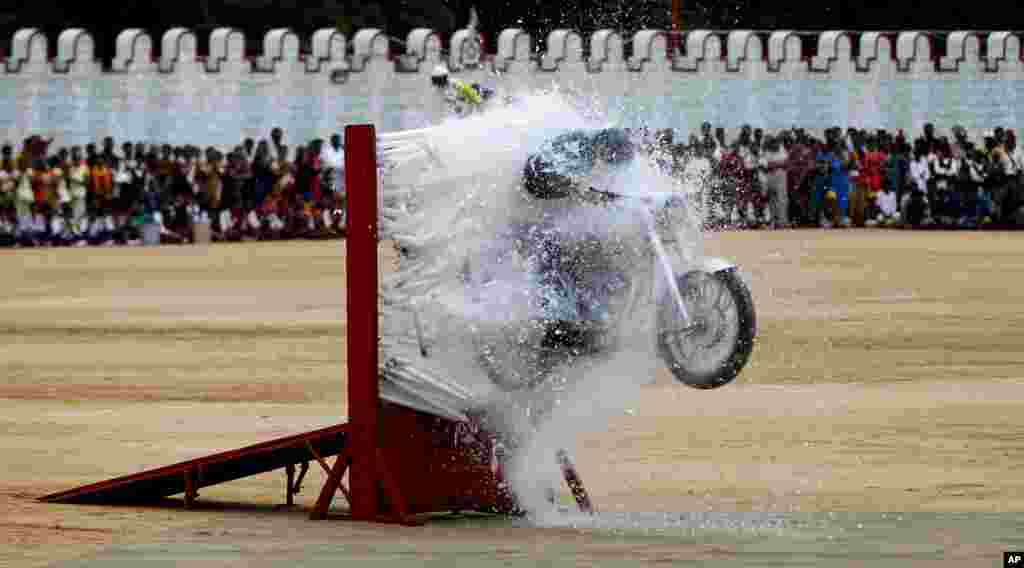 An Indian army officer performs a stunt on a motorcycle during a function to mark India's Independence Day in Bangalore, India.