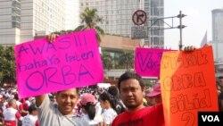 Aksi para netizer di Jakarta dan sekitarnya atas lahirnya UU Pilkada berlansung di Bundaran HI Jakarta Minggu 28 September. (VOA/Andylala)