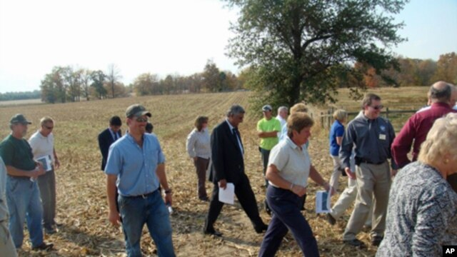 Afghan Agriculture Minister Asif Rahimi tours an Indiana farm with members of the Agriculture Development Team that worked closely with him in Afghanistan in 2009.