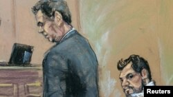 FILE - Mehmet Hakan Atilla, right, who works for Halkbank in Turkey, is shown in this courtroom sketch with his attorney, Gerald J. DiChiara, in U.S. District Court in Manhattan, March 28, 2017.