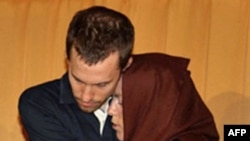 Detained US hiker Shane Bauer hugging his mother Cindy Hickey in Tehran.