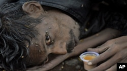 A homeless man in Hyderabad, India. The U.N.'s new development goals aim to eradicate extreme poverty.