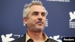 Mexican film director Alfonso Cuaron, a member of the jury at the 72nd Venice Film Festival, poses during a photo call for the event in Venice, Italy, Sept. 2, 2015.