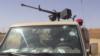 Des balles ont visé un véhicule de l'armée nigérienne, à la prison de Koutoukalé, lors d'une attaque terroriste, au Niger, le 17 octobre 2016. (VOA/Abdoul-Razak Idrissa)