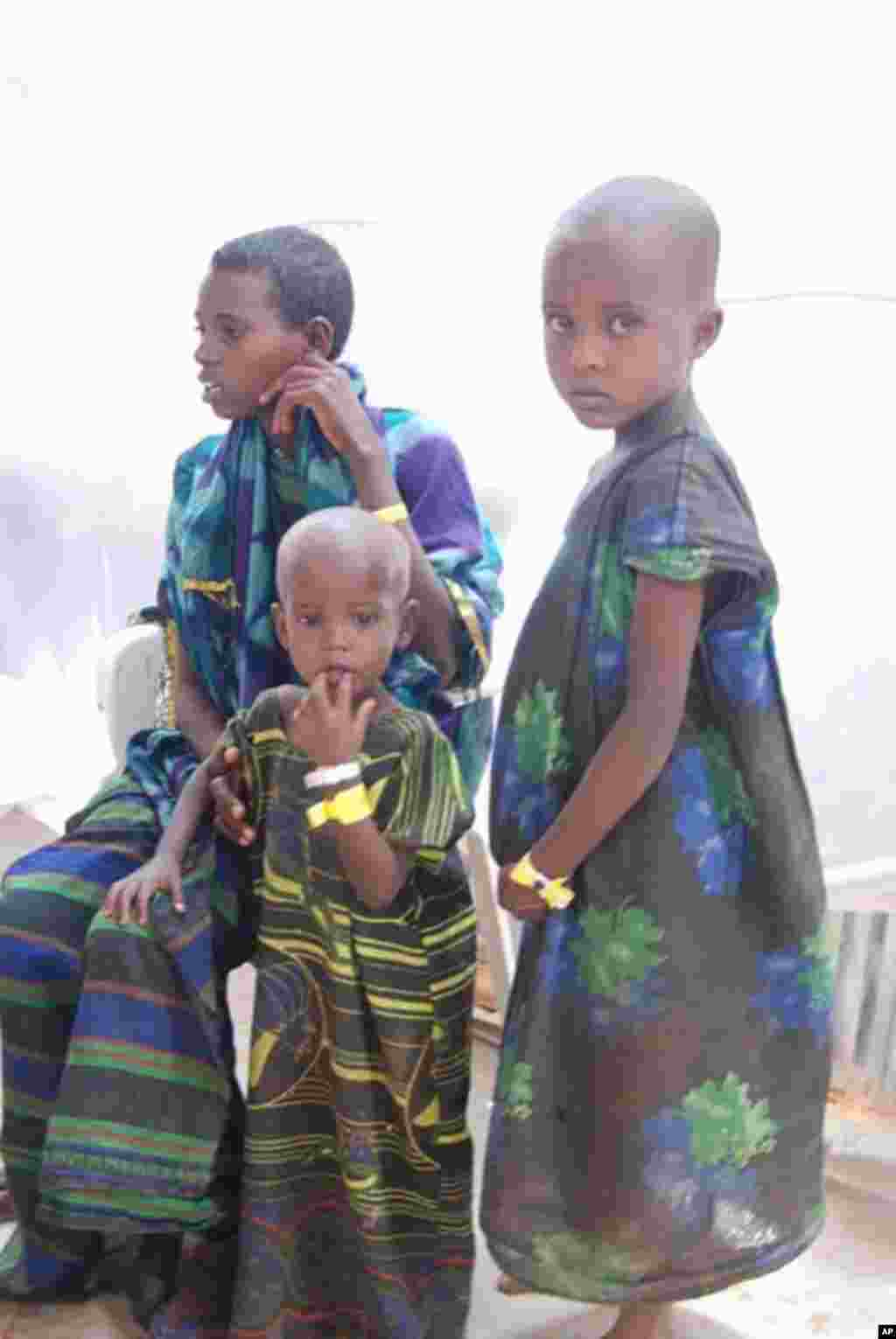 Boys sometimes dress as girls on the journey to avoid being taken and pressed into service at checkpoint set up by Islamic extremist groups that control much of southern Somalia. VOA - P. Heinlein