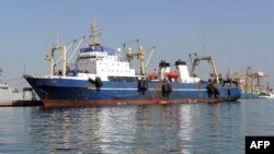 "FILE - A Russian trawler ""Oleg Naïdenov"",is moored in Dakar on January 5, 2014. The ship was boarded after it was observed illegally fishing in Senegalese waters near the border with Guinea Bissau."