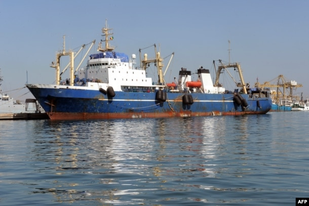 "FILE - A Russian trawler ""Oleg Naïdenov"", is moored in Dakar on Jan. 5, 2014. The ship was boarded after it was observed illegally fishing in Senegalese waters near the border with Guinea Bissau."