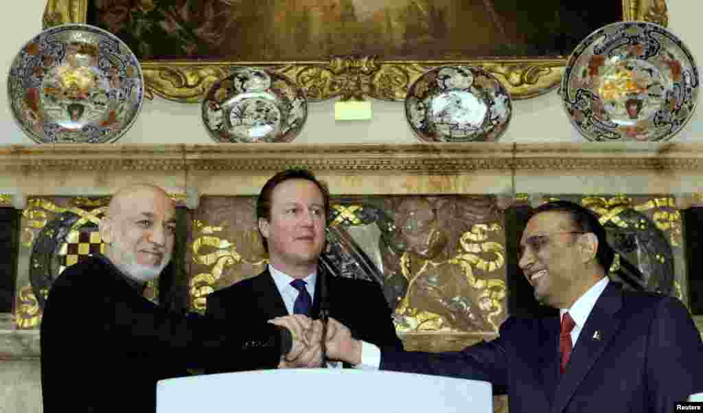 Britain's Prime Minister David Cameron shakes hands with Afghan President Hamid Karzai and Pakistan's President Asif Ali Zardari, at Cameron's country residence, Chequers, west of London, February 4, 2013.