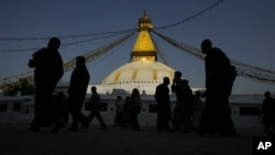 Buddhists and tourists take a round of Bodhnath stupa, in Katmandu, Nepal, Thursday, March 5, 2009. Situated on an early trade route between Katmandu and Lhasa, Bodhnath was a religious site. The present stupa, Nepalís largest, was constructed probably in