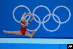 Angelina Melnikova of Russia performs her floor exercise during the women's artistic gymnastic qualifications at the 2020 Summer Olympics, July 25, 2021, in Tokyo.