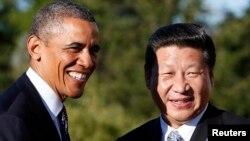 6일 러시아 상트페테르부르크에서 열린 주요 20개국 정상회담에서, 바락 오바마 미 대통령과 시진핑 중국 국가주석이 악수하고 있다.
