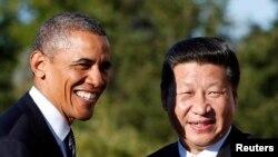 奥巴马与习近平相会。