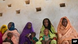 FILE - Mothers wait for their children to be examined for signs of malnutrition at a walk-in nutrition clinic in Barrah, a desert village in the Sahel belt of Chad, April 20, 2012. UNICEF estimates that 127,000 children under five in Chad's Sahel belt wi
