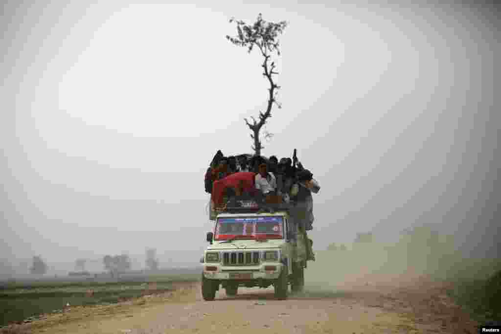 "An overloaded vehicle transports people returning from the ""Gadhimai Mela"" festival held in Bariyapur, Nov. 29, 2014. Sword-wielding Hindu devotees in Nepal began slaughtering thousands of animals and birds in a ritual sacrifice, ignoring calls by animal rights activists to halt what they described as the world's largest such exercise."