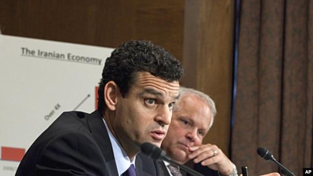 Treasury Undersecretary David Cohen, left, accompanied by Commerce Undersecretary David Mills, testifies on Capitol Hill in Washington, October 13, 2011.