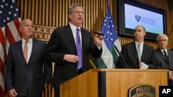 Mayor Bill deBlasio, second from left, along with Police Commissioner James O'Neil, far left, FBI Assistant Director William Sweeney, second from right, and NYPD Deputy Commissioner of Intelligence and Counterterrorism John Miller, far right, hold a news conference on the latest in the package bomb investigation, Thursday Oct. 25, 2018, in New York.