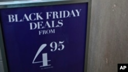"An H&M store advertises ""Black Friday Deals"" on Saturday, Nov. 23, 2013, in New York."