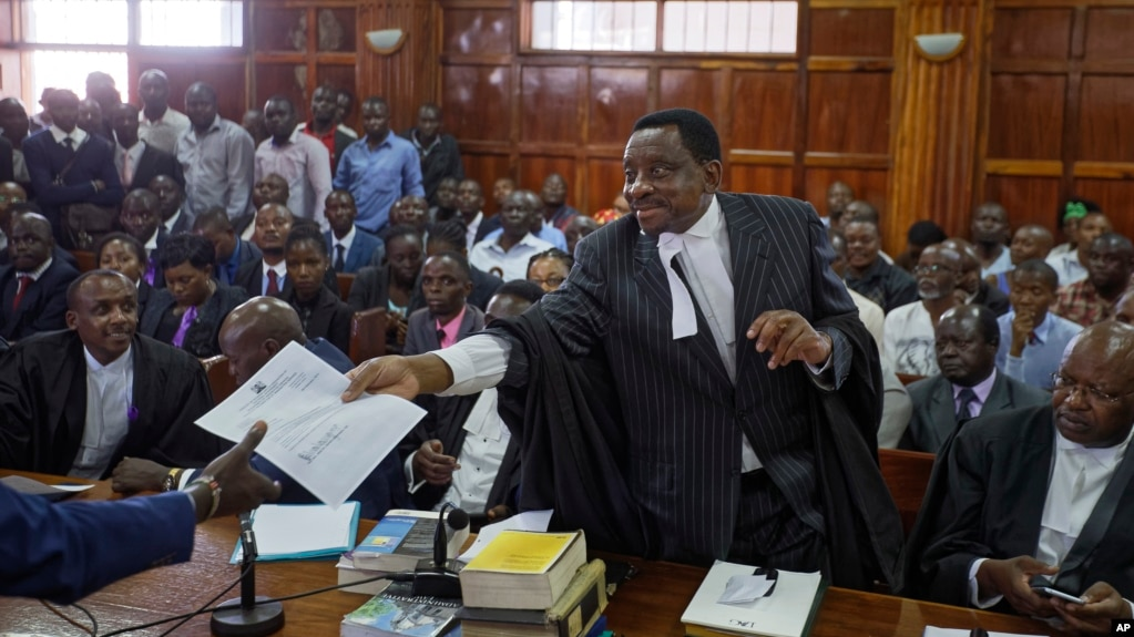 Opposition lawyer and party official James Orengo hands a letter informing him that his own passport has been suspended by the government, to the judge in the case of opposition politician Miguna Miguna, at the High Court in downtown Nairobi, Kenya, Feb.
