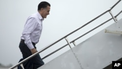 Republican presidential candidate Mitt Romney boards his campaign plane, October 9, 2012, in Newport News, Virginia.