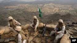 FILE - Saudi soldiers occupy a position on Mt. Doud, Jan. 27, 2010, a high strategic position in the southern Saudi province of Jizan, near the border with Yemen, that was occupied by Houthi rebels from Yemen, and retaken by the Saudi military.