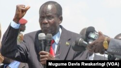 South Sudan Vice President James Wani Igga, shown here addressing demonstrators at a peace rally in Juba in March 2014, urges South Sudanese who have fled the country to come home and help build a unified nation.