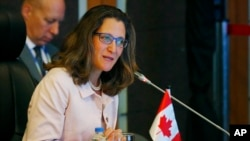 FILE - Canadian Foreign Minister Chrystia Freeland delivers her statement during the ASEAN-Canada ministerial meeting, Aug. 6, 2017 south Manila, Philippines.