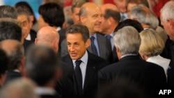 Президент Франции Николя Саркози и глава МИД Франции Ален Жюпе на конференции в Париже. 31 августа 2011 г.