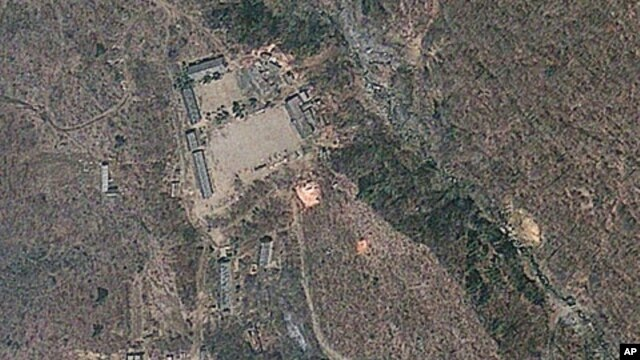Satellite image provided by GeoEye appears to show a train of mining carts, at the lower center of the frame, and other preparations underway at North Korea's Punggye-ri nuclear test site but no indication of when a detonation might take place, April 18,