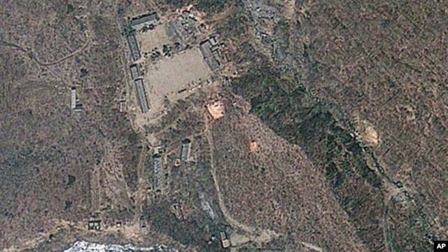 Satellite image provided by GeoEye appears to show a train of mining carts, at the lower center of the frame, and other preparations underway at North Korea's Punggye-ri nuclear test site, April 18, 2012.
