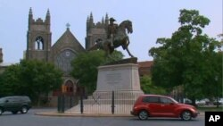 Leaders of the Confederacy are memorialized in monuments dominating one of Richmond, Virginia's main boulevards.