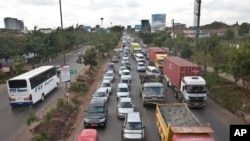 FILE - Drivers sit in queues of traffic on a highway in downtown Nairobi, Kenya.
