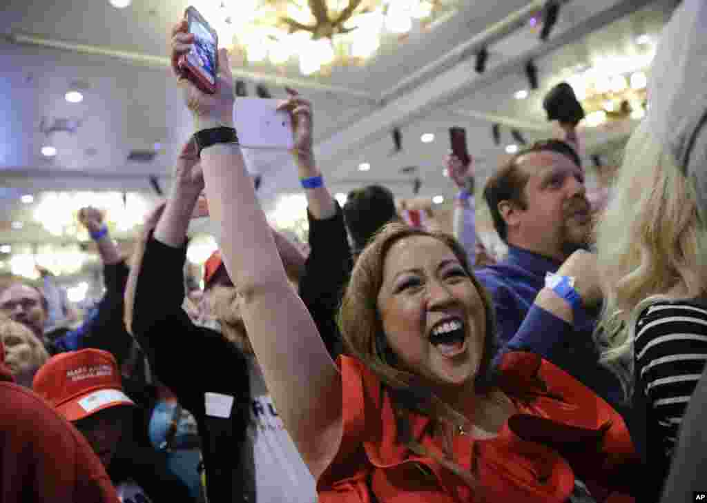 Supporters cheer during a caucus night rally for Republican presidential candidate Donald Trump, Feb. 23, 2016.