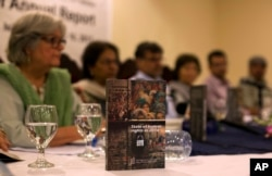 FILE - The Human Rights Commission of Pakistan presents the 2016 annual human rights report, in Islamabad, Pakistan, May 10, 2017. The report offered a mixed report card in its annual look at the state of human rights in Pakistan.