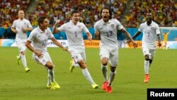 Jermaine Jones of the U.S. celebrates with Alejandro Bedoya (11), Matt Besler (5) and DaMarcus Beasley after scoring a goal during the 2014 World Cup G soccer match between Portugal and the U.S. at the Amazonia arena in Manaus June 22, 2014.