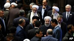 Iran's President Hasan Rouhani, center, leaves the parliament at the end of his swearing-in ceremony for the second term in office, in Tehran, Iran, Aug. 5, 2017.